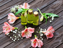 Skin care products and pink flowers Stock Images