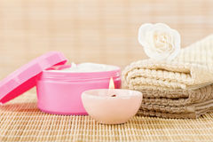 Skin care set with romantic candle Stock Photography