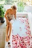 Skin Care Spa Treatment. Woman On Bathtub. Flower Rose Bath. Royalty Free Stock Photography