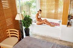 Skin Care Spa Treatment. Woman On Bathtub. Flower Rose Bath. Royalty Free Stock Image