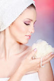 Skin care with sponge. Pretty woman taking skin care with sponge Royalty Free Stock Photos