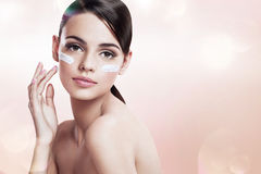Skin care teenage girl putting face cream Stock Photo