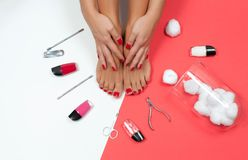 Beautiful female feet and hands at spa salon on pedicure and manicure procedure stock photos