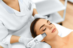 Skin Care. Ultrasound Cavitation Facial Peeling. Skin Cleansing. Skin Care. Close-up Of Beautiful Woman Receiving Ultrasound Cavitation Facial Peeling Royalty Free Stock Photography