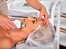 Skin care of ultrasound facial peeling. Ultrasonic cleansing procedure. stock image