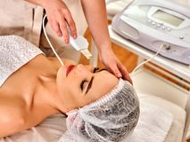 Skin care of ultrasound facial peeling. Ultrasonic cleansing procedure. Stock Photography