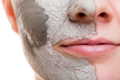 Skin care. Woman applying clay mask on face. Spa. Skin care. Closeup of female face. Young woman applying clay mask. Girl taking care of her dry compexion Stock Photography