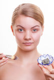 Skin care. Woman applying clay mask on face. Spa. Royalty Free Stock Photo