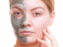 Skin care. Woman applying clay mask on face. Spa. Royalty Free Stock Photography