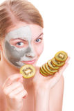 Skin care. Woman applying clay mask on face. Spa. Royalty Free Stock Images