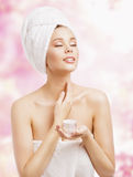 Skin Care, Woman Applying Cream in Bath Towel after Spa, Treatme Stock Photography