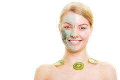 Skin care. Woman in clay mask with kiwi on face. Skin care. Woman in clay mud mask on face and necklace with slices of kiwi fruit isolated. Girl taking care of Royalty Free Stock Photo