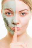 Skin care. Woman in clay mud mask on face. Beauty. Stock Images