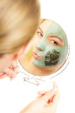 Skin care. Woman in clay mud mask on face. Beauty. Royalty Free Stock Photos