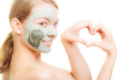 Skin care. Woman in clay mud mask on face. Beauty. Royalty Free Stock Images