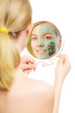 Skin care. Woman in clay mud mask on face. Beauty. Stock Photos
