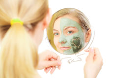 Skin care. Woman in clay mud mask on face. Beauty. Royalty Free Stock Photo