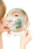 Skin care. Woman in clay mud mask on face. Beauty. Stock Photography