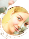 Skin care. Woman in clay mud mask on face. Beauty. Royalty Free Stock Photography