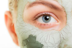 Skin care. Woman in clay mud mask on face. Beauty. Skin care. Woman in clay mud mask on face isolated on white. Girl taking care of dry complexion. Beauty stock image