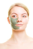 Skin care. Woman with clay mud mask on face. Royalty Free Stock Photo