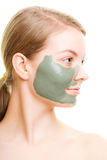 Skin care. Woman with clay mud mask on face. Stock Images