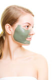 Skin care. Woman with clay mud mask on face. Royalty Free Stock Photography