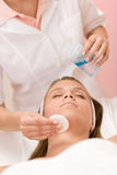 Skin care - woman cleaning face Stock Photo