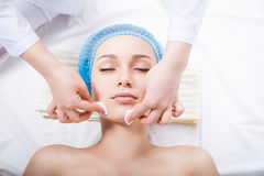 Skin care - woman cleaning face by beautician Royalty Free Stock Images