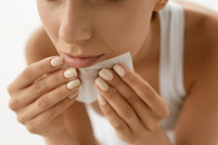Skin Care. Woman Cleaning Face With Oil Absorbing Papers. Stock Photography