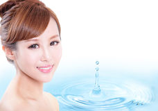 Skin care woman face with smile. Water drop background, concept for cosmetic, beauty hygiene, makeup, moisturize, model is a asian beauty Royalty Free Stock Photo