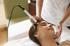 Skin Care. Woman Getting Facial Oxygen Jet Peeling Treatment. Face Skin Care. Closeup Of Beautiful Woman Getting Oxygen Jet Peeling, Microdermabrasion Treatment stock photo