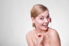 Skin care. woman girl with red leaf and cream Stock Photos