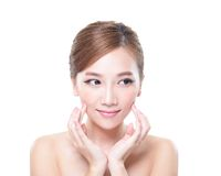 Skin care Woman look to empty copy space. Beautiful Young Skin care Woman look to empty copy space isolated on white background, asian Stock Images
