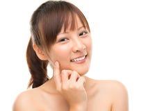Skin care woman putting face cream royalty free stock photos