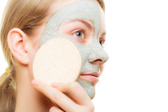Skin care. Woman removing clay mud facial mask Stock Photos