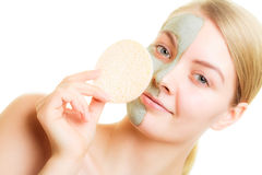 Skin care. Woman removing clay mud facial mask Royalty Free Stock Photography