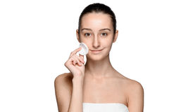 Skin care woman removing face with cotton swab pad Stock Photo