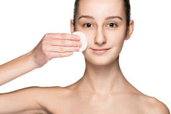 Skin care woman removing face with cotton swab pad Royalty Free Stock Image