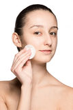 Skin care woman removing face with cotton swab pad Stock Photography