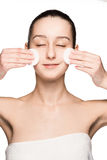Skin care woman removing face with cotton swabs Stock Photo
