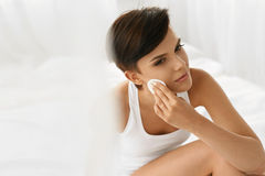 Skin Care.  Woman Removing Face Makeup, Cleansing Beauty Face Royalty Free Stock Images