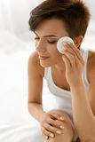 Skin Care.  Woman Removing Face Makeup, Cleansing Beauty Face Royalty Free Stock Photos
