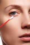 Skin care woman removing face makeup with cotton swab. Skin care concept. Caucasian model with perfect skin. Beauty & Spa. Royalty Free Stock Image