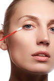 Skin care woman removing face makeup with cotton swab. Skin care concept. Caucasian model with perfect skin. Beauty & Spa. Royalty Free Stock Photography