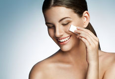 Skin care woman removing face makeup - skin care concept Royalty Free Stock Images