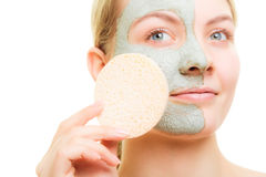 Skin care. Woman removing facial clay mud mask. Stock Photo