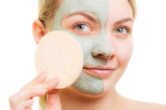 Skin care. Woman removing facial clay mud mask. Stock Images