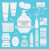 Skin cares products icons set on blue background Stock Images