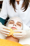 Skin clarification. Cosmetician cleaning the face of a young woman with pads Stock Images